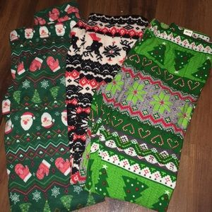 Three pairs of Christmas leggings
